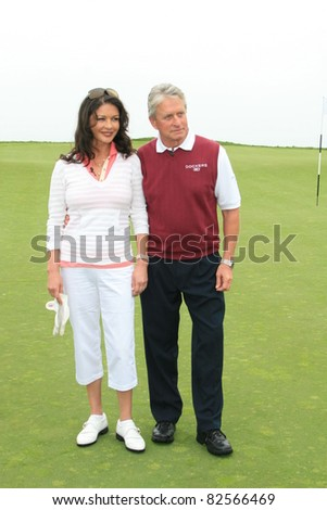 PALOS VERDES - APR 29: Catherine Zeta Jones; Michael Douglas at the 9th annual Michael Douglas + friends Celebrity Golf Tournament at the Trump National Golf Club in Palos Verdes, CA on April 29, 2007 - stock photo