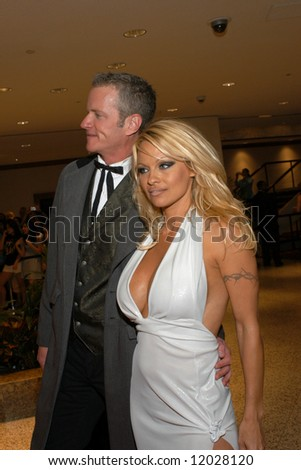 Pamela Anderson and PETA senior VP Dan Matthews arrive at the White House Correspondents' Dinner April 26, 2008 in Washington, D.C.