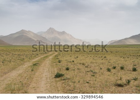 Pamir highway. Marco Polo silk road. Gorno Badakhsan province, Tajikistan. Central Asia Pamir Highway leads from Kyrgyzstan to Murghab via Wakhan valley to Khorog (Afgan border) and then to Dushanbe. - stock photo
