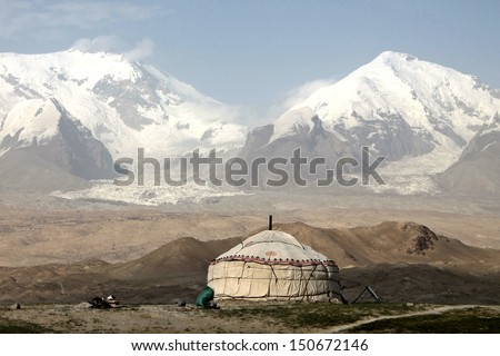 Pamir Karakorum Highway Mushtaq Ata Peak at Karakul Lake - stock photo