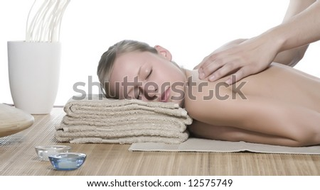 Pampered young woman with male hands doing a massage. - stock photo