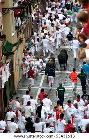 PAMPLONA-JULY 9:Bull running in the calle Estafeta. Fiesta de San Fermin, Pamplona, Navarra, Spain 9 July 2008 in Pamplona Spain