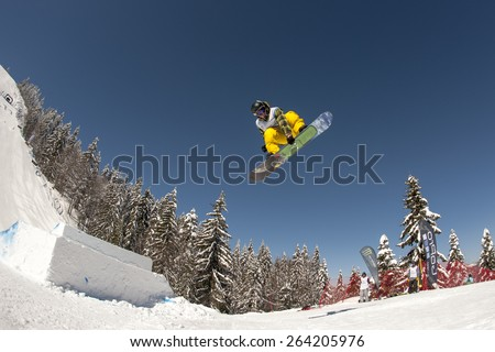 "PAMPOROVO,BULGARIA - MARCH 17 : Competitor performs trick during the ""Pamporovo Freestyle Open 14-19 March 2015"" in Pamporovo,Bulgaria on March 17, 2015"