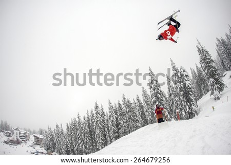 "Pamporovo,Bulgaria - March 14,2015 : Nikolaj Najdenov (BUL) performs trick during the ""Pamporovo Freestyle Open 14-19 March 2015"" in Pamporovo,Bulgaria on March 14, 2015 - stock photo"