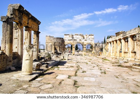 PAMUKALLE, TURKEY - OCTOBER 07, 2014: Ancient Hierapolis. Its ruins currently comprise an archaeological museum designated as a UNESCO World Heritage Site. - stock photo