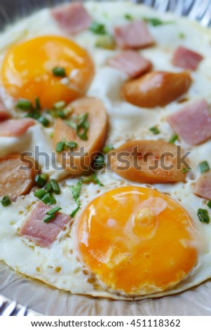 pan egg with ham and sausages