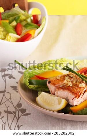 Pan Fried Salmon Steak in garlic oil - stock photo
