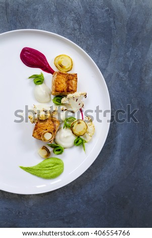 Pan fried salmon with pea, beetroot and cauliflower puree, roast leeks, cauliflower and asparagus ribbons