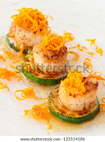 Pan fried scallops with citrus zest close-up - stock photo
