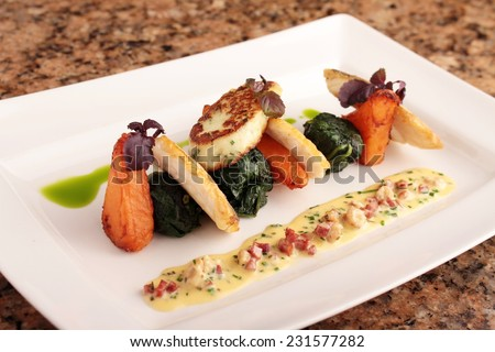 pan fried sea bass plated dinner meal  - stock photo