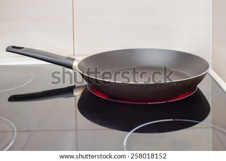 Pan on the cooker - stock photo