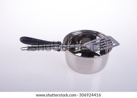 pan with utensils on the background