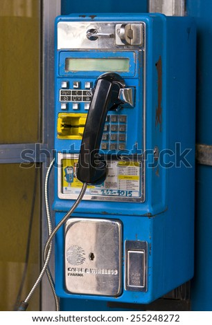 PANAMA CITY, PANAMA - AUGUST 10, 2009: Pay telephone in phone booth, Casco Viejo, historic city center. - stock photo