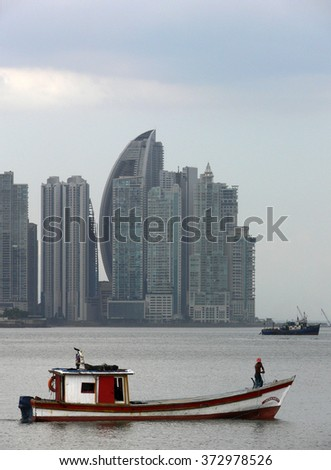 PANAMA CITY/PANAMA - CIRCA FEBRUARY 2012: Fisherman boat in Pacific Ocean and, behind, the Panama City skyline
