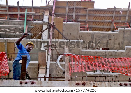 PANAMA CITY, PANAMA, DECEMBER 20 2006.  Panamanian construction workers posing for the camera in a construction yard in Panama City, on December 20th 2006. FOR EDITORIAL USE ONLY. - stock photo