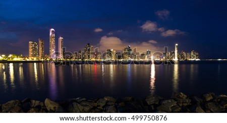 Panama City, Panama- June 08: Twilight Cityscape from across the bay in Panama with a serene reflection on the water. June 08 2016, Panama City, Panama.