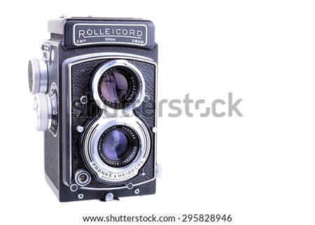 PANAMA, PANAMA - JULY 11, 2015: The Rolleicord was a popular medium-format twin lens reflex camera made by Franke & Heidecke between 1933 and 1976.  Old Rolleicord TLR camera isolated on a white