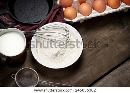 Pancake ingredients: flour, eggs and milk - stock photo