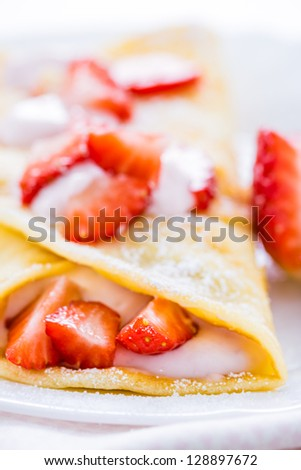 pancake with fresh strawberries sprinkled with sugar and ricotta - stock photo