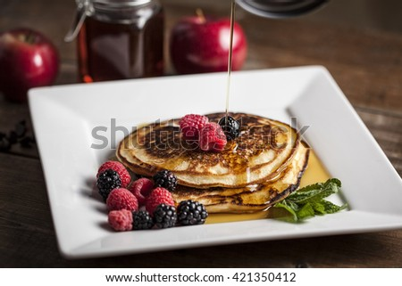 Pancake with maple syrup and fruits - stock photo