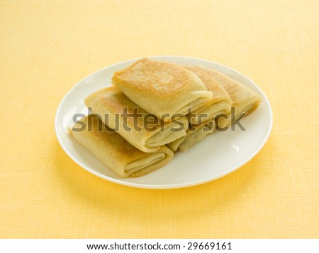 Pancakes (blini) on a plate - stock photo