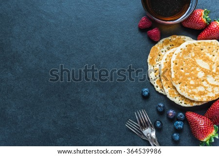 Pancakes border background, overhead - stock photo