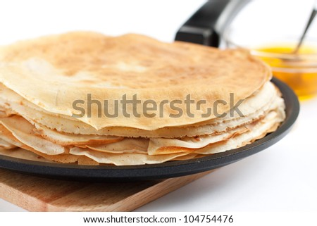 Pancakes in a frying pan. Fresh, delicious dessert - stock photo