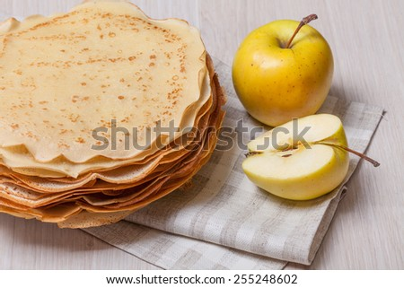 Pancakes pile with apples