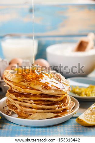 Pancakes poured with maple syrup - stock photo