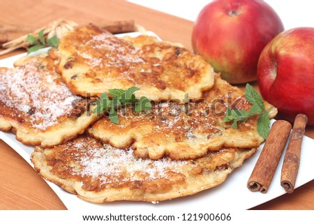 Pancakes with apples and cinnamon - stock photo