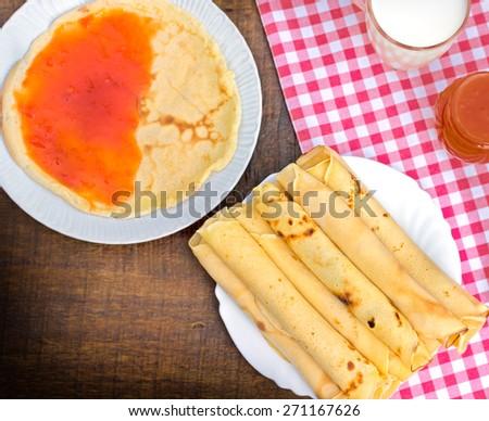 Pancakes with apricot jam - marmalade - stock photo