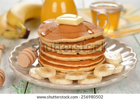 Pancakes with banana on a white background - stock photo