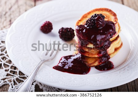 Pancakes with BlackBerry jam.selective focus. - stock photo