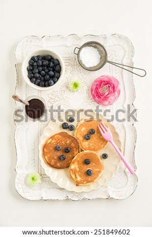 Pancakes with blueberries on vintage tray - stock photo