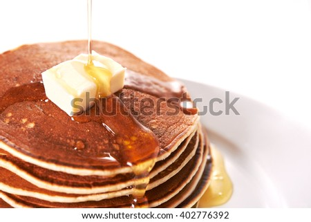 pancakes with buttermilk and syrup over white background - stock photo