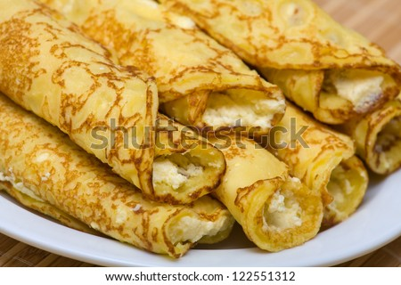 Pancakes with cheese in white plate
