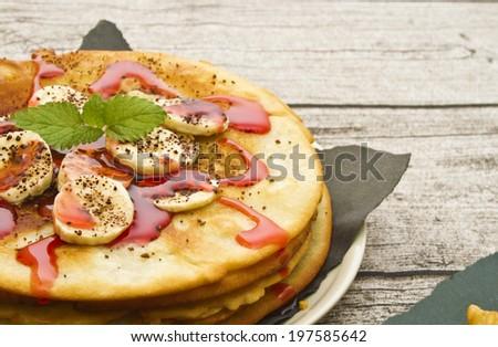 pancakes with chocolate ice cream and strawberry sauce. - stock photo
