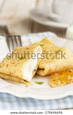 Pancakes with cottage cheese and cloudberry jelly