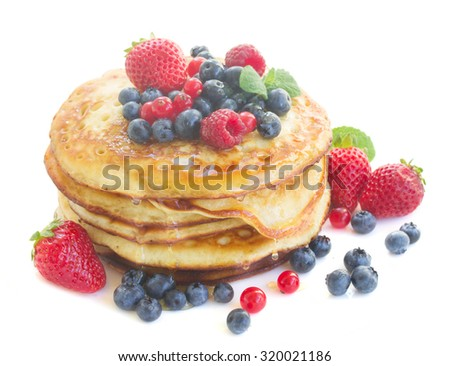Pancakes with  fresh berries isolated on white background