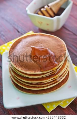 pancakes with honey - stock photo