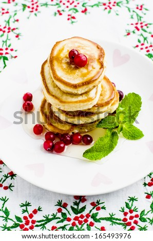 Pancakes with honey and cranberries for breakfast on Valentine's Day - stock photo