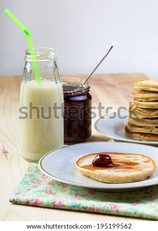pancakes with jam  at the table