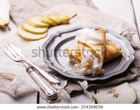 Pancakes with pear and yogurt,topped with chocolate.selective focus. - stock photo