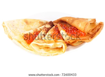 Pancakes with red caviar on the white dish - stock photo
