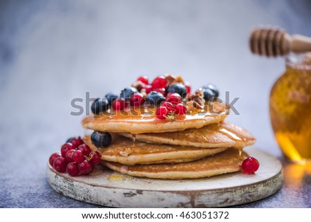 pancakes with redcurrant and berries, healthy brunch idea