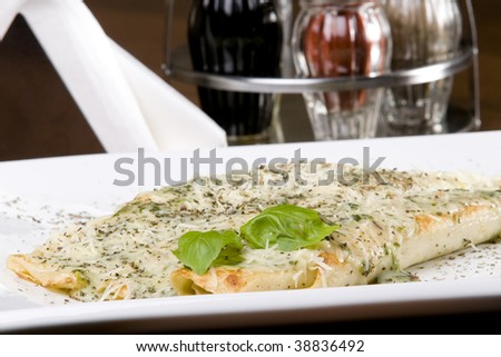 pancakes with spinach and cheese - stock photo