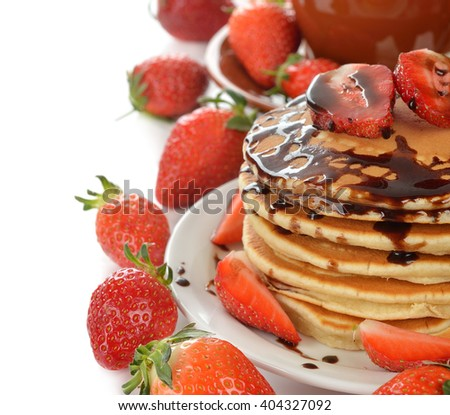 Pancakes with strawberries on a white background - stock photo