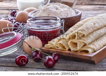 pancakes with whole wheat flour and domestic eggs and cherry jam - stock photo