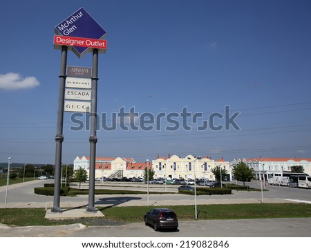 PANDORF, AUSTRIA - AUGUST 2, 2014: An exterior view of McArthur Glen outlet mall in Pandorf, Austria, on August 2, 2014.  - stock photo