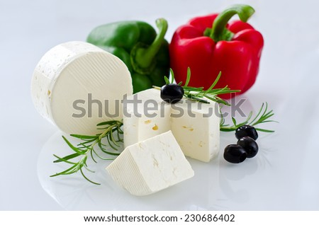 Paneer cheese on white background, horizontal, selective focus - stock photo